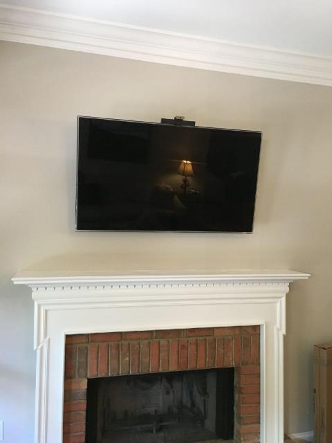 Atlanta, GA - Installed new receptacle and HDMI cable behind t.v. over fireplace and mounted t.v.