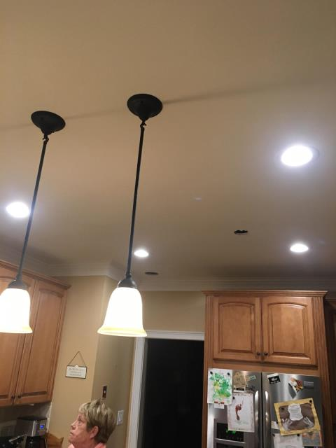 Peachtree City, GA - Removed old kitchen light and installed new led recessed lights; installed new pendant lights; removed dining table chandelier and installed new led recessed lights; install new led recessed lights in living room