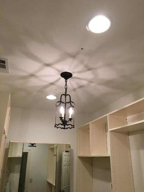 Newnan, GA - Removed existing lights in laundry room, hallway and master closets and installed recessed lights