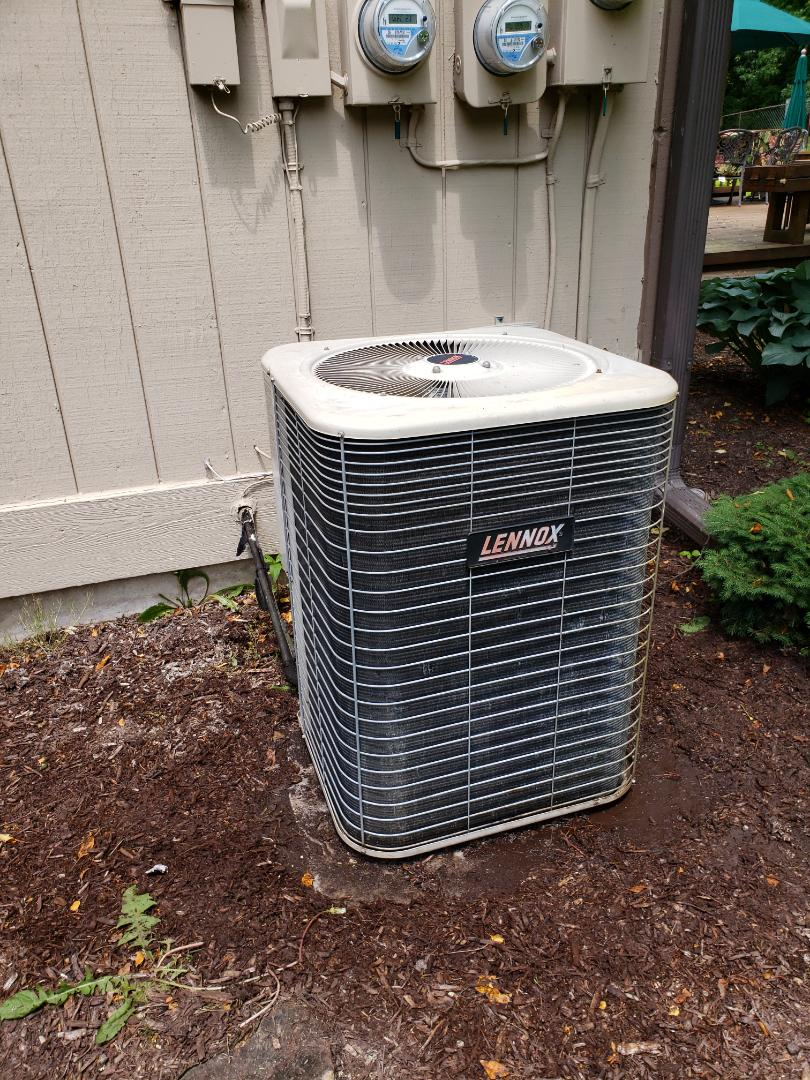 Brighton, MI - Annual air conditioning system maintenance on lennox high efficiency air conditioning system.