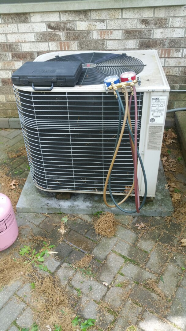 Brighton, MI - Adjust refrigerant levels and test unit operation.
