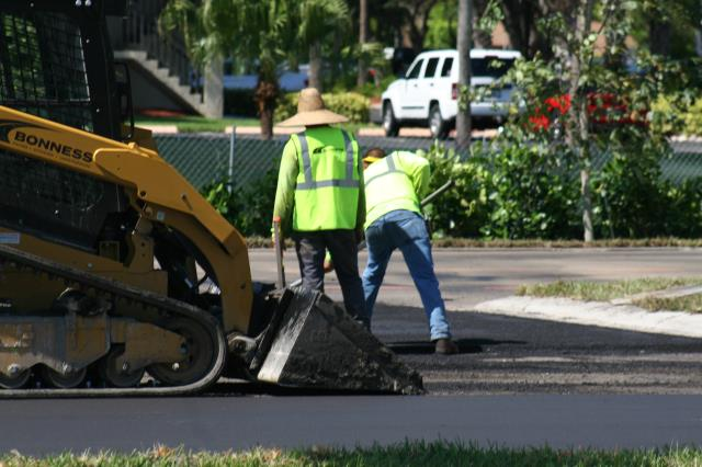 Naples, FL - Finishing asphalt at one of our projects in Naples, Florida.