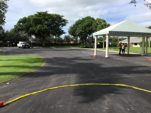 Naples, FL - Parking lot work getting done over at Moorings Park in Naples