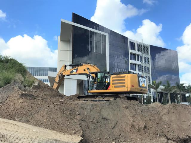 Naples, FL - Excavator on one of our job sites