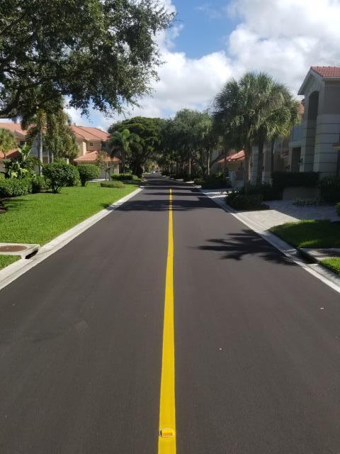 Bonita Springs, FL - Here is some sealcoating and pavement marking work Bonness did over at Hamptons at Bonita Bay.