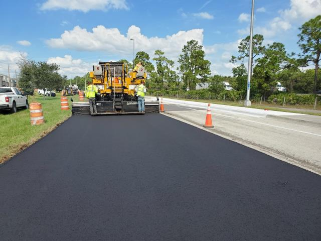 Fort Myers, FL - Paving crew doing some work over by 3 oaks parkway