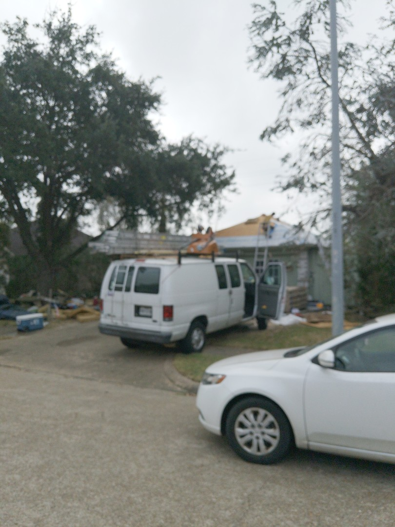 Cypress, TX - Roof going on in Cypress.  Bought for wind damage.