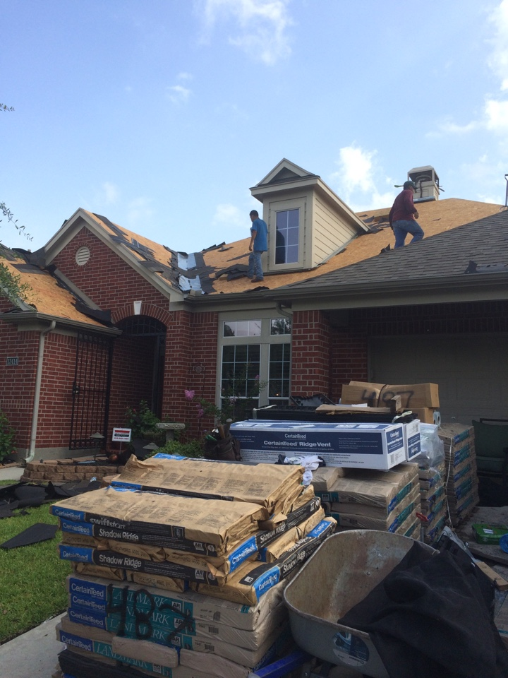 Cypress, TX - Another day with another Certainteed Landmark Weather Wood shingle going on.