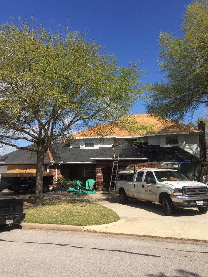 Huntsville, TX - A CertainTeed Landmark Morie Black Roof replacement due to hail damage.
