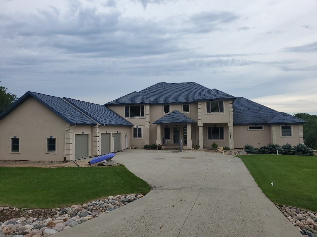 Pelican Rapids, MN - Old asphalt roof. New roof going on this beautiful lake home on Franklin lake.