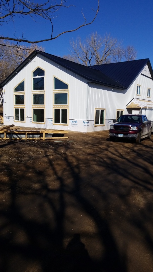 Pelican Rapids, MN - Custom Pelican Lake home.  Seamless Board and Batten with Standing Seam Metal Roofing.