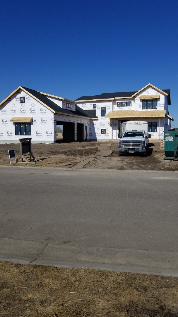 Fargo, ND - New Construction.  Certainteed Landmarks shingles along with standing seam metal roofing accents.   Great looking place
