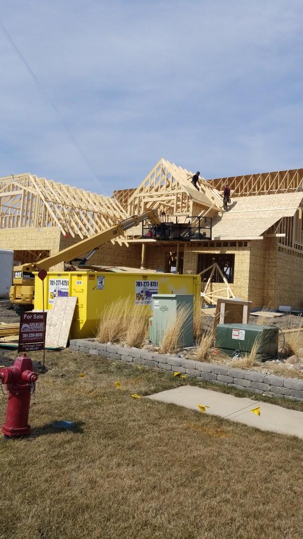 West Fargo, ND - New construction roofing in Riversbend neighborhood.