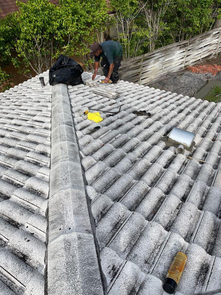Venice, FL - Repairing a leak in a tile roof.