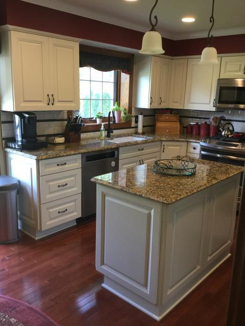 New White painted kitchen cabinets with Toasted Almond Glaze, new engineer hardwood floors, Portofino granite tops,  under cabinet low voltage lighting, and tiled back splash with accent stripe.