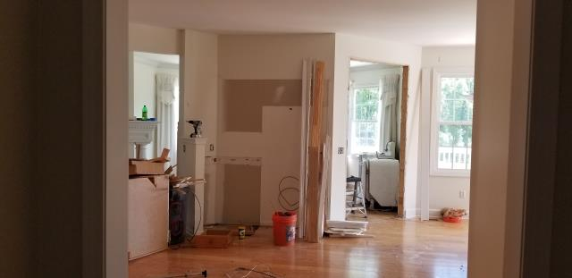 Canton, MI - Started a new kitchen remodel today, before picture of wall removal for an open kitchen floor plan.  Existing wood floor will be removed for new pre-finished engineered wood flooring.