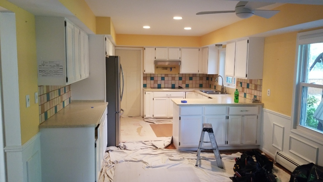 Start of a kitchen tear out in Plymouth.  Existing hard floors stay and protected.  Cabinets and counter tops will be donated to Habitat for Humanity.