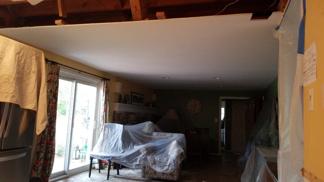 Going to remove or raise the ceiling in the family room area for openness