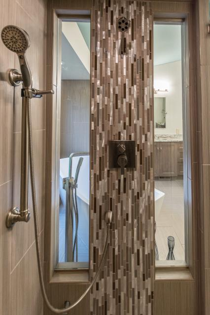 This steam shower is an ideal way to pamper yourself and not feel closed in.  Beautiful tile work.  When you're done with the steam multiple shower heads to clean your self off with.