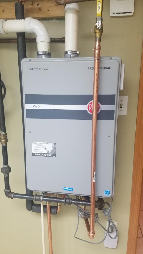 Ham Lake, MN - Tankless water heater repair. No hot water. Circuit breaker tripping. Faulty recirculating pump tripping breaker.