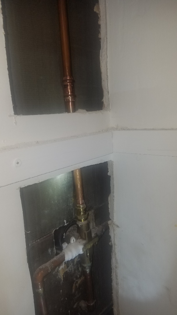 Water pipe repair. Replace leaking pipe to shower head.
