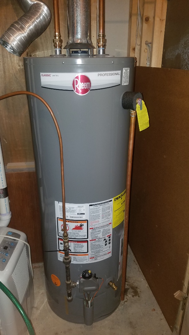 Shoreview, MN - New Rheem water heater installation.  Replace leaking older water heater. Water pipe repair.