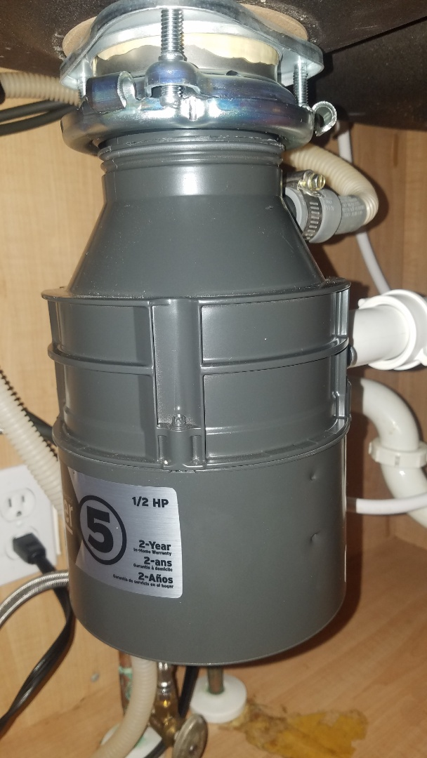 Leaking garbage disposal. Install new Badger 5 food waste disposal.