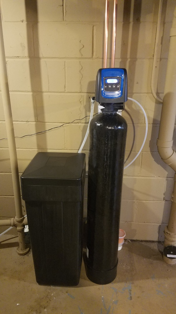 Water softener service. Old water softener. New water softener installation.
