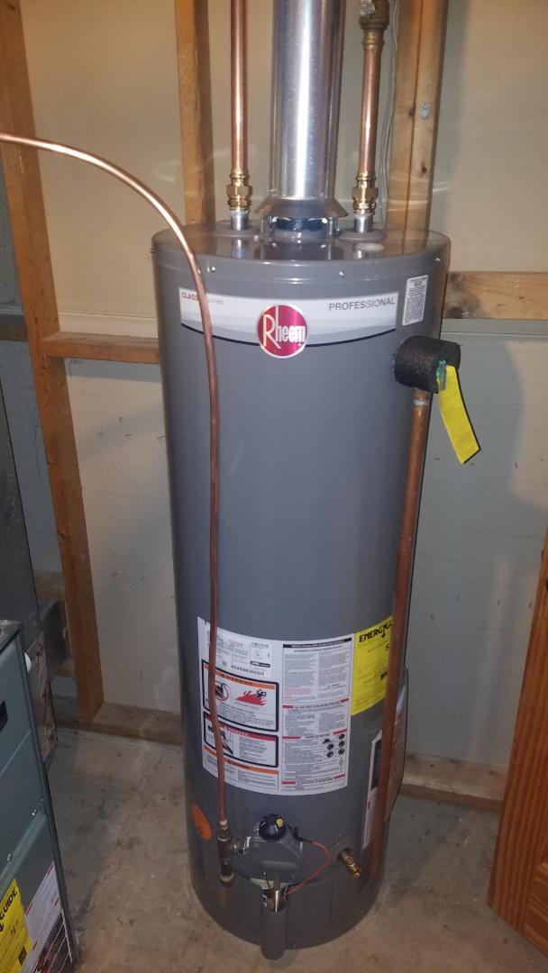 Coon Rapids, MN - Water heater leaking. New water heater installation. Rheem water heater.
