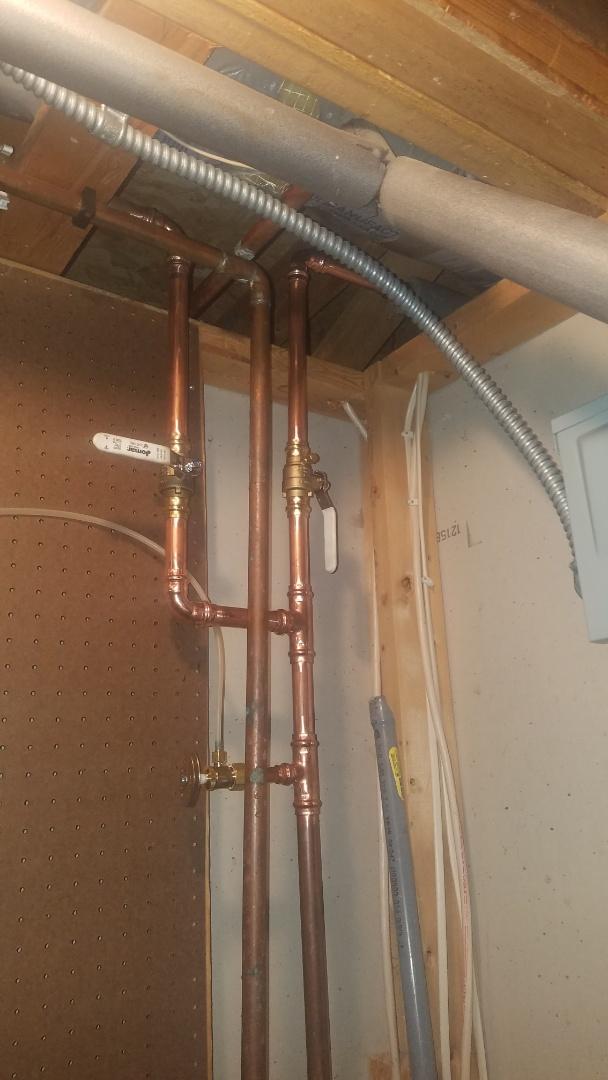Water pipe repair. Replace lawn faucet shut off valves.
