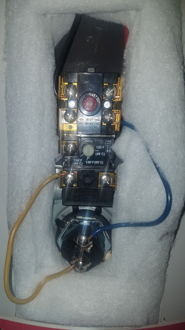 Electric water heater repair. Test and replace thermostats.