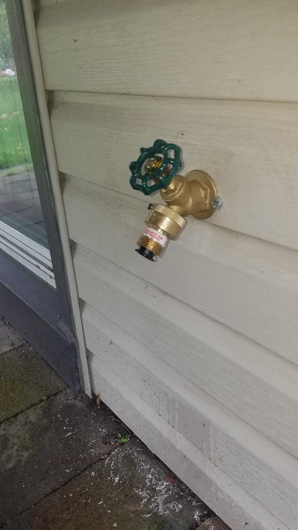 Lawn faucet repair. Replace vacuum breaker and handle.