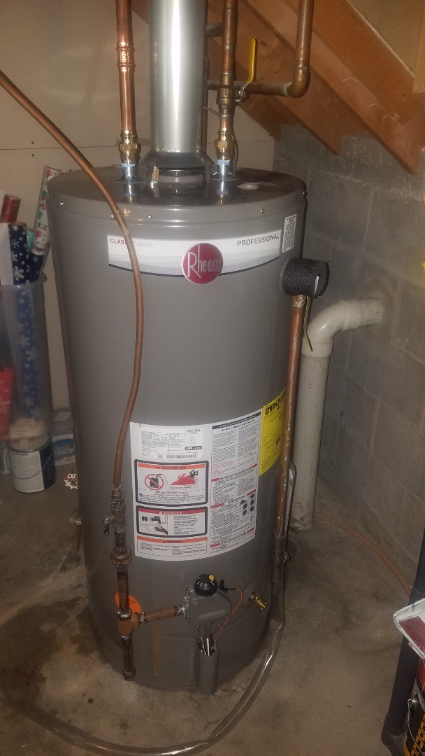 Leaking water heater. Emergency water heater installation.  40 gallon Rheem water heater.