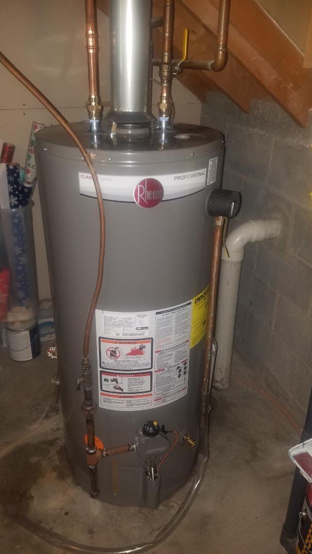 American water heater not working properly.  Install new Rheem water heater.
