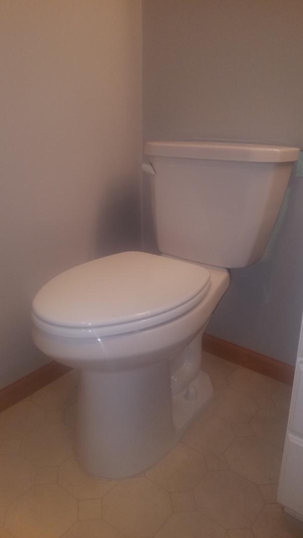 Leaking toilet.  Tighten bolts on toilet tank.