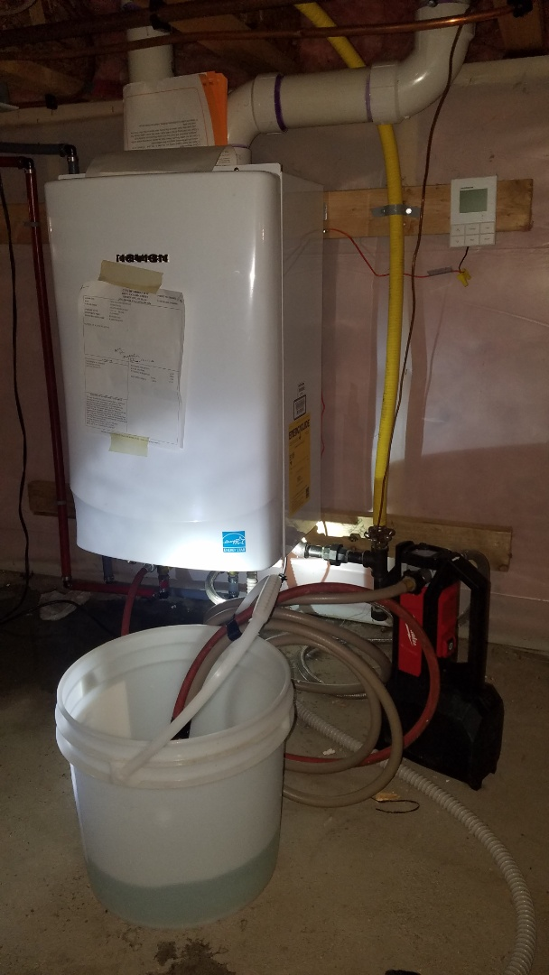 Shoreview, MN - Tankless water heater service. Flush water heater with cleaning solution.  Install new safety relief valve.