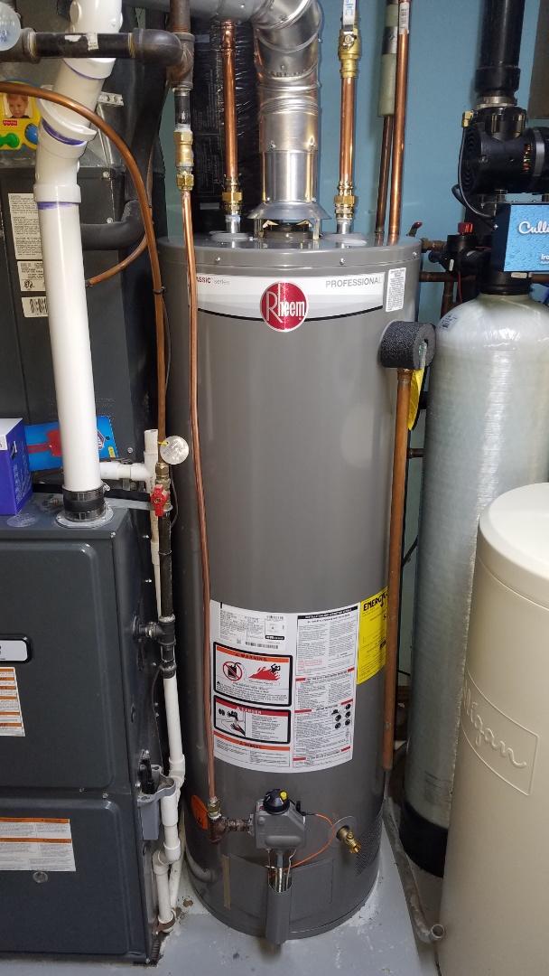 Emergency water heater service.  Leaking water heater.  Rheem 40 gallon tall water heater installation.
