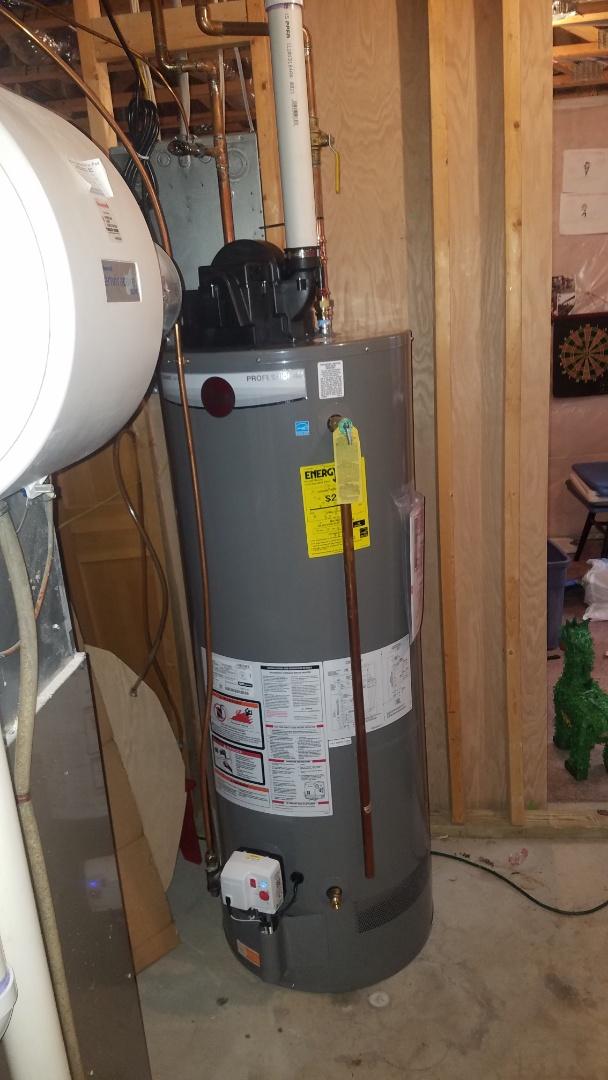 Water heater replacement.  Installing new Rheem water heater.