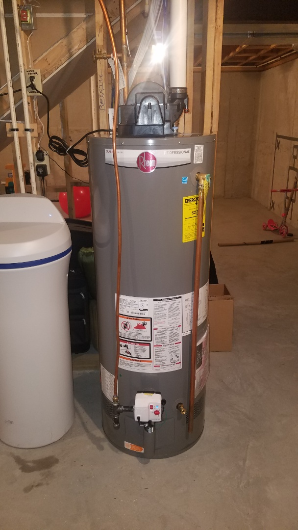 Water  heater service.  Repair leaking pipes above water heater.