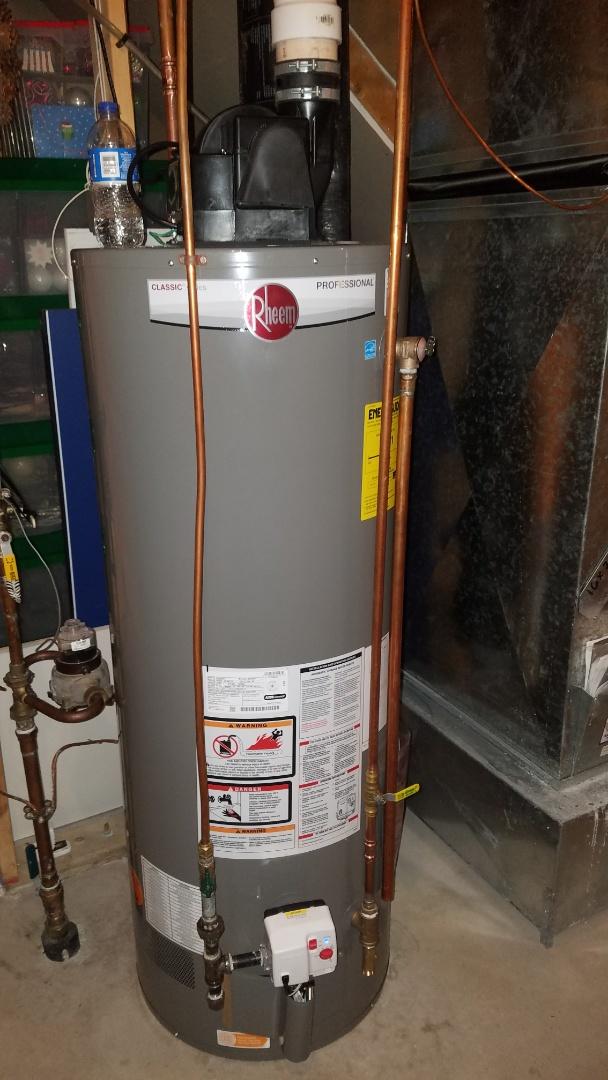 Arden Hills, MN - Leaking water heater. New Rheem water heater installation.