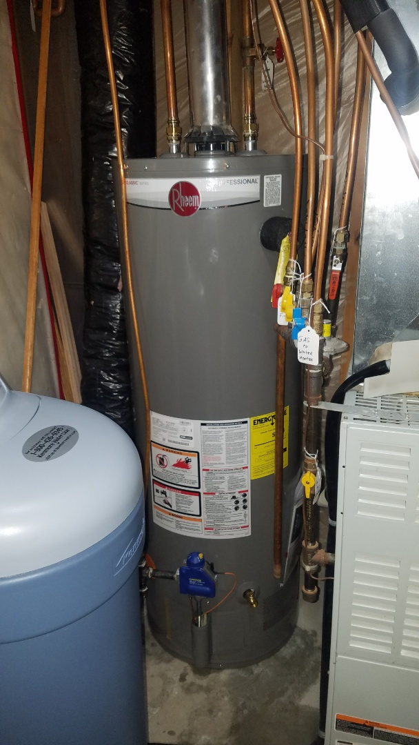 Lino Lakes, MN - leaking water heater. new water heater installation. Rheem 50 gallon gas water heater installation.