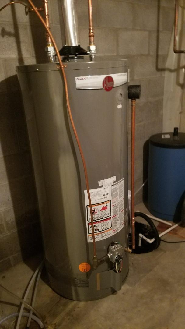 New Brighton, MN - Leaking water heater.  New Rheem water heater installation.