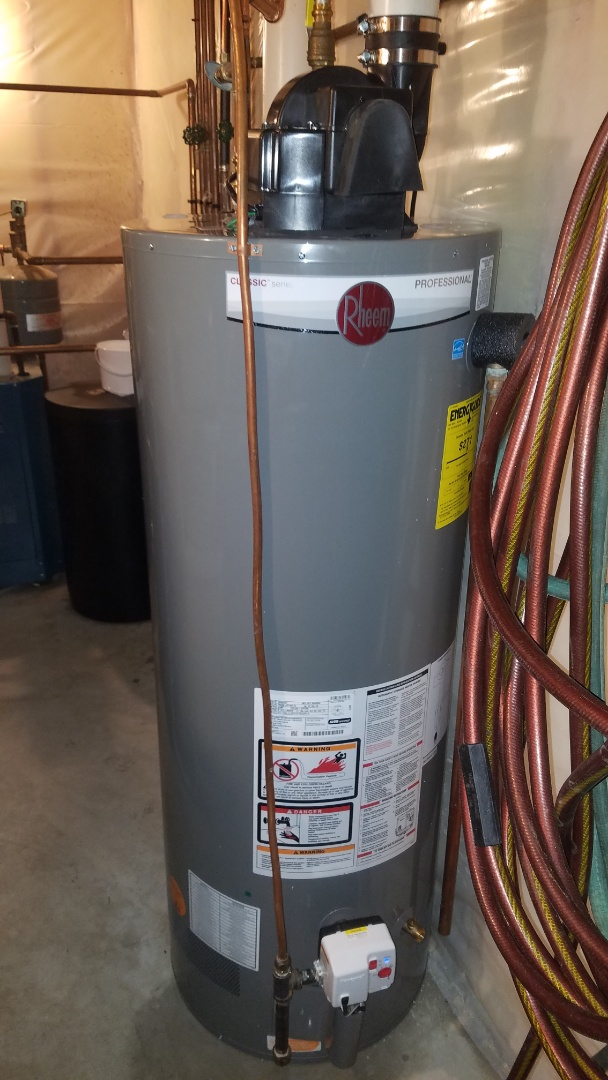 Shoreview, MN - Leaking water heater. New Rheem power vent water heater install.