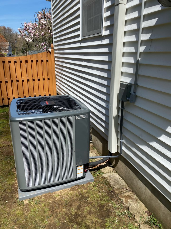 Installation/replacement of a central air conditioning system for whole house Amana hi efficiency two stage.