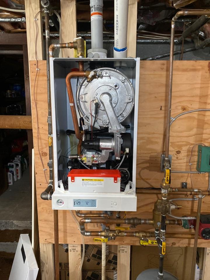Preventive maintenance on a Viessmann condensing boiler natural gas.
