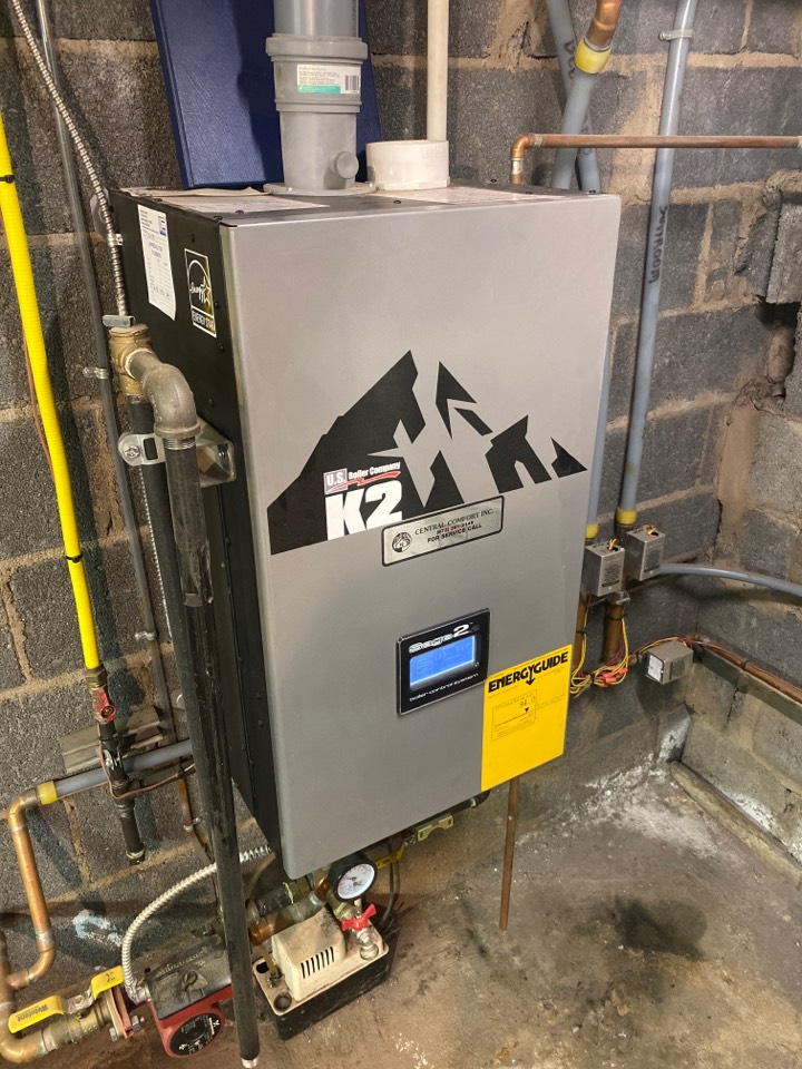 Preventive maintenance on a Burnham K2 high-efficiency natural gas boiler and indirect water heater.