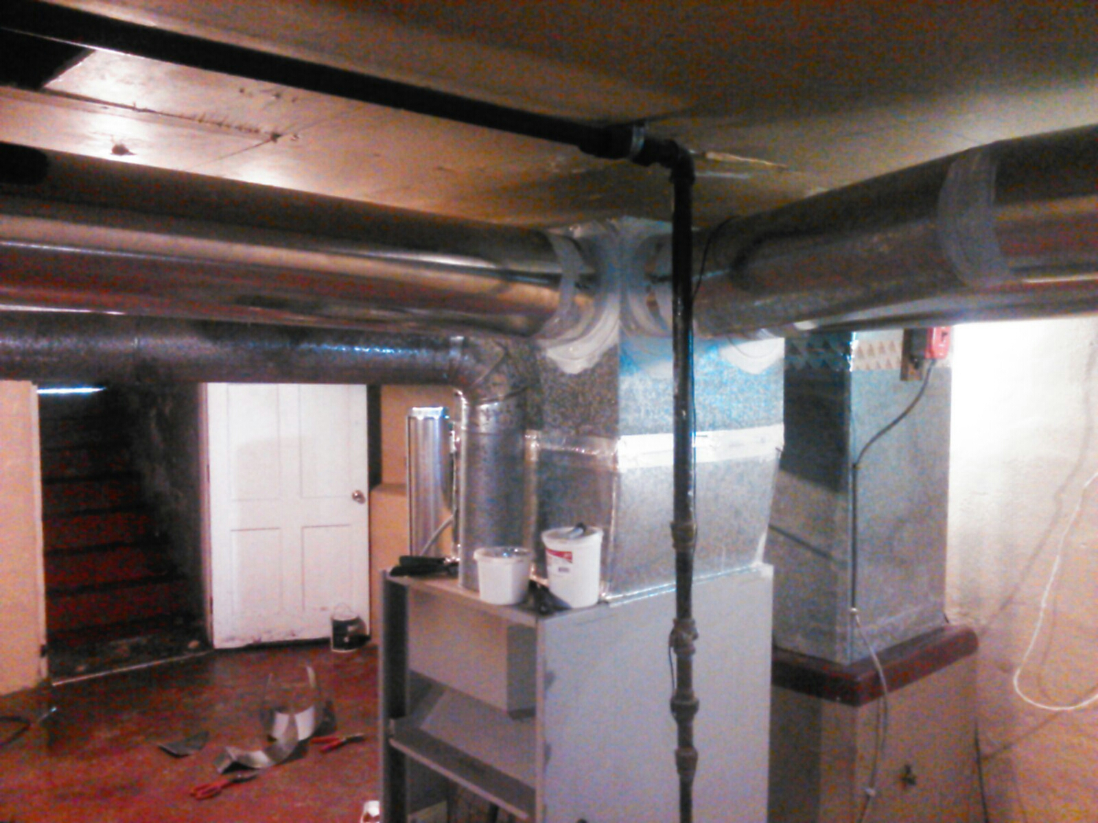 Morris Plains, NJ - Reattach hard pipe to Heil furnace and seal ductwork