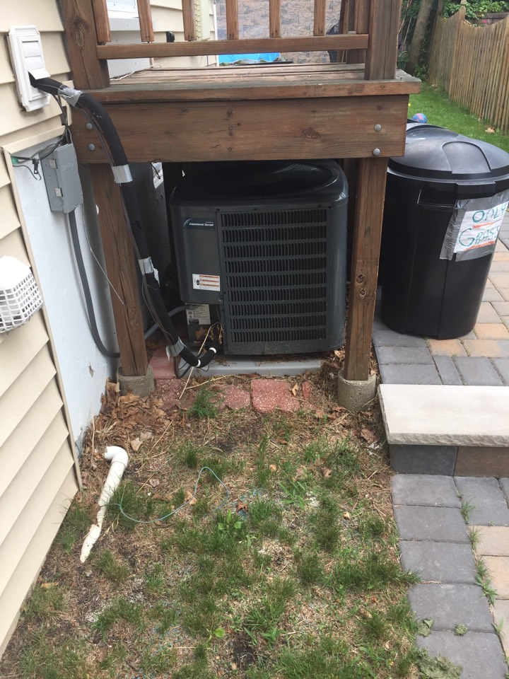 Dover, NJ - Air conditioning service. Unit blowing warm air. Found condenser under deck. AC service.