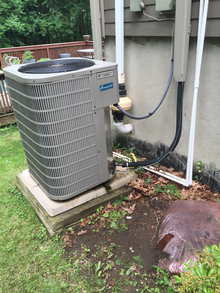 Byram Township, NJ - Air conditioning service call. Unit not blowing cold air. Foind unit low on refrigerant. Repair condenser with leak protector and charge ac system.