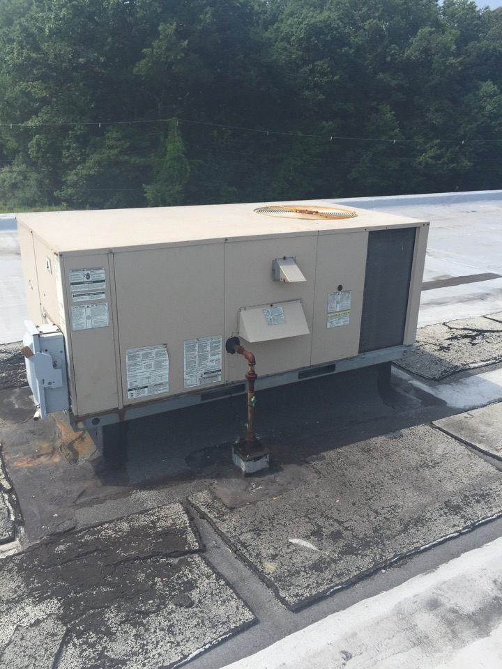 Randolph, NJ - Commercial air conditioning service call. Air not cooling room. Found bad condenser fan motor. Replace motor.
